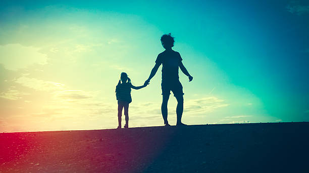 Royalty Free Daughter And Father Holding Hands Pictures Images And