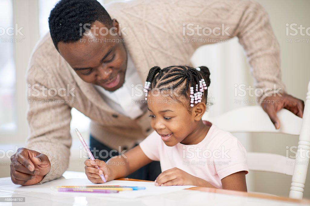 Father and Daughter Homework stock photo