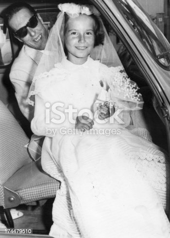 57520540 istock photo Father and daughter in 1958,first communion day. 174479510