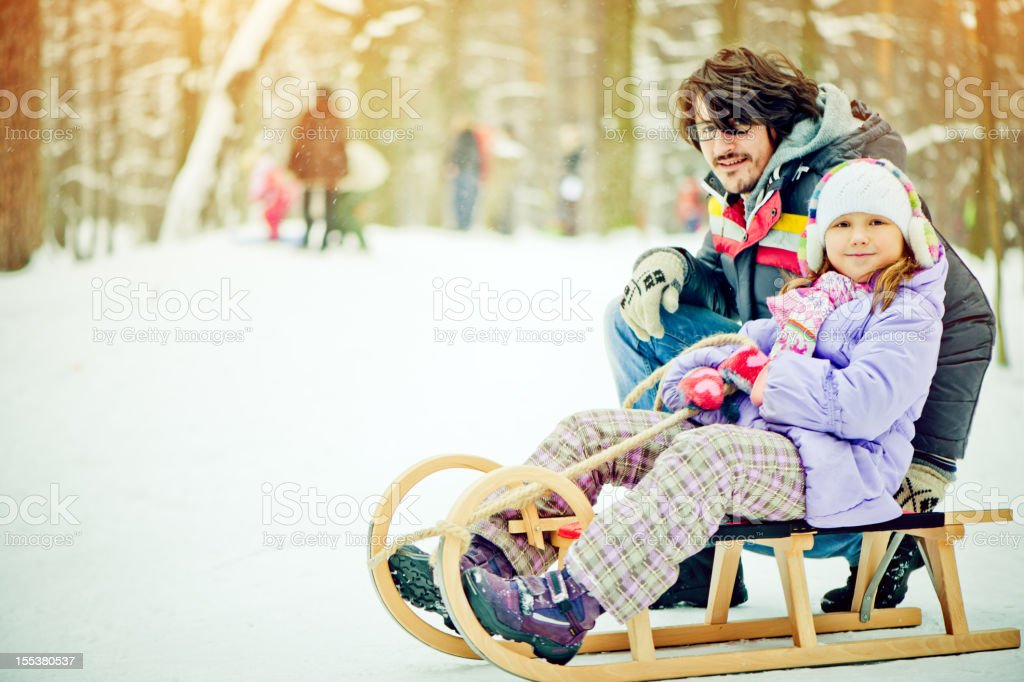 Father and daughter in a winter park royalty-free stock photo