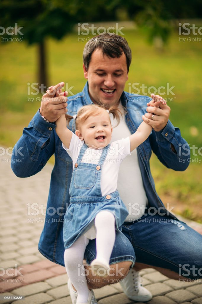 Father and daughter in summer park royalty-free stock photo