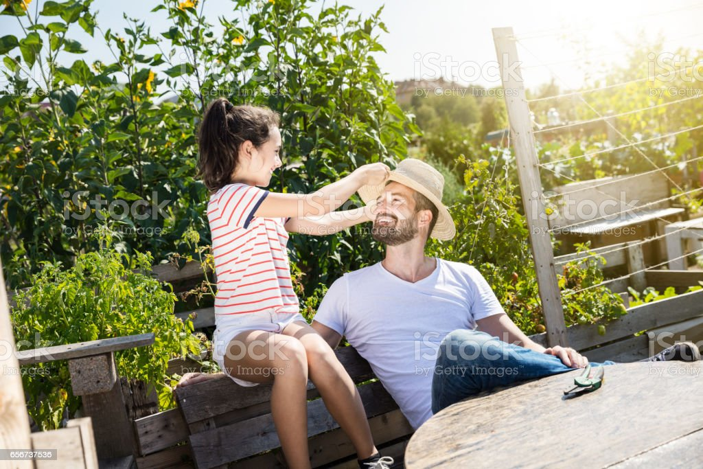 Father and daughter in the garden stock photo