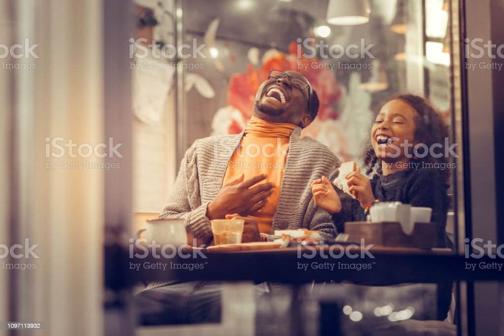 Father and daughter laughing out loud feeling happy together Feeling happy together. Father and daughter laughing out loud feeling happy together at the weekend Adult Stock Photo