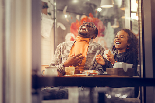 Father And Daughter Laughing Out Loud Feeling Happy Together Stock Photo - Download Image Now