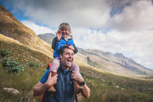 Father and Daughter Laughing with Delight in the Outdoors stock photo