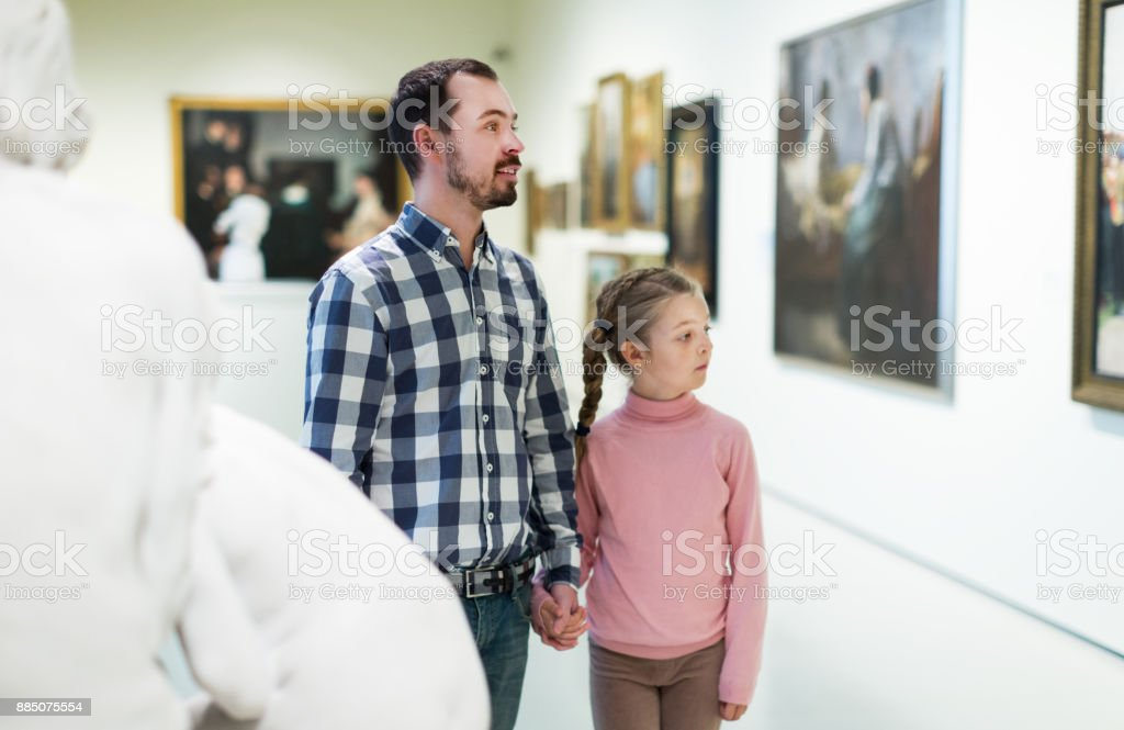 Father and daughter looking at expositions stock photo
