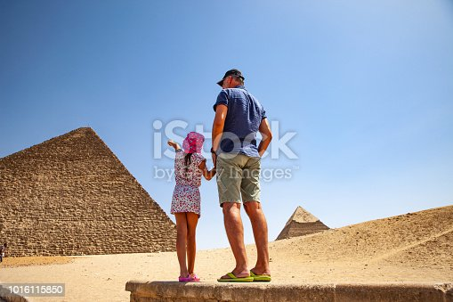 istock Father and Daughter Looking at Kheops Pyramid in Giza 1016115850