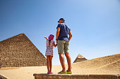 Father and Daughter Looking at Kheops Pyramid in Giza.
