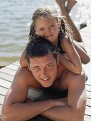 istock Father and daughter lying on a pier 71563184