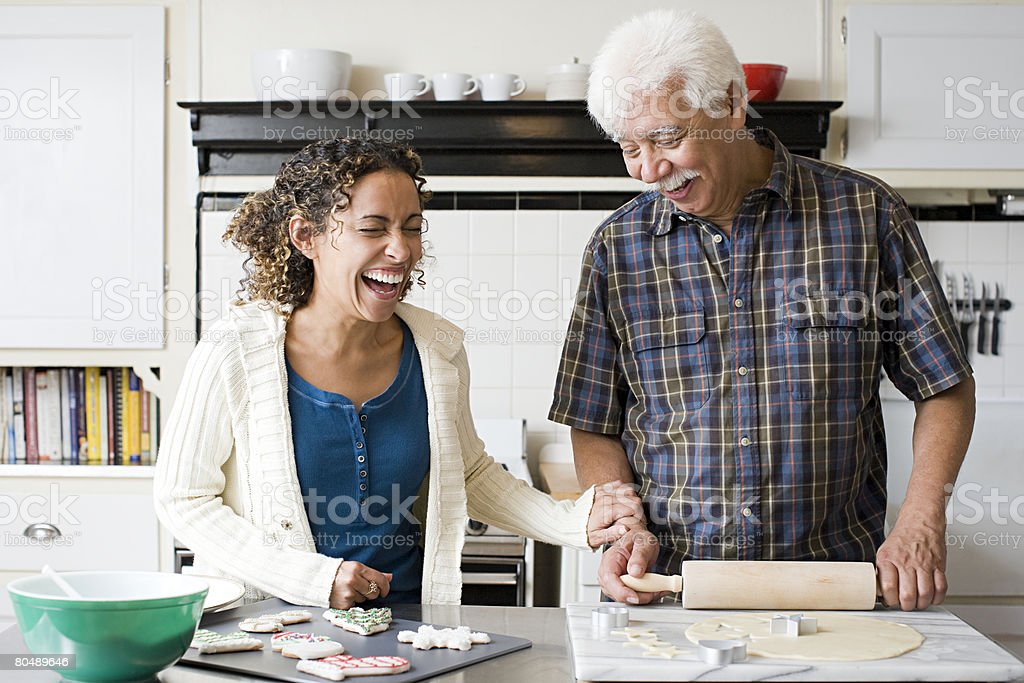 A father and daughter making cookies stock photo