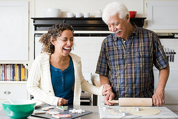 a father and daughter making cookies - father and daughter stock photos and pictures