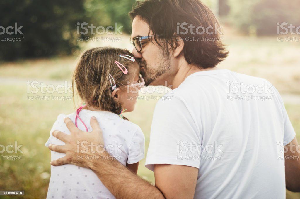 Father and daughter moments together outdoors stock photo