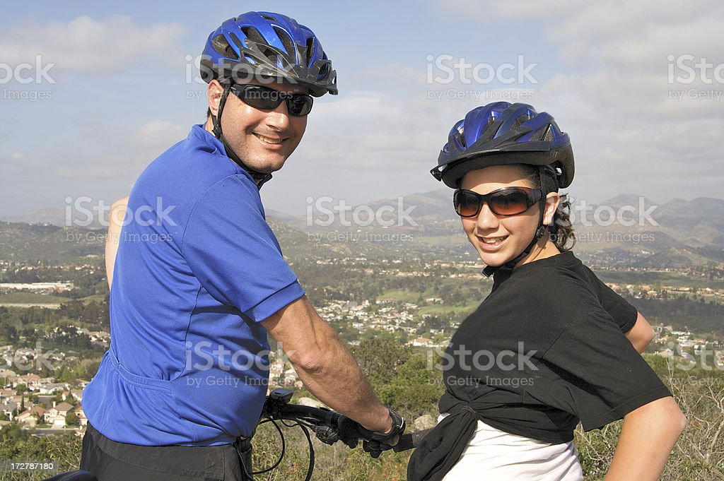 Father and Daughter Mountain Biking royalty-free stock photo