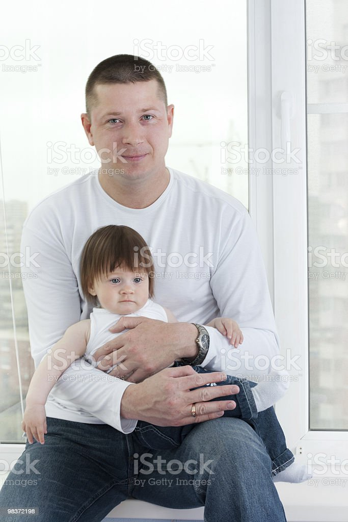 father and daughter near window royalty-free stock photo