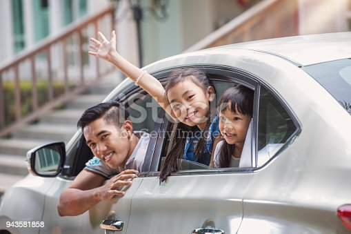 istock Father and daughter on car and smile from car windows 943581858