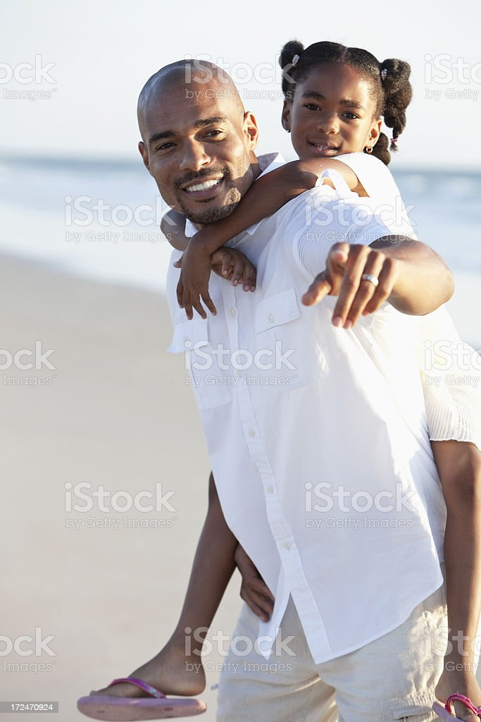 Father and daughter on the beach royalty-free stock photo