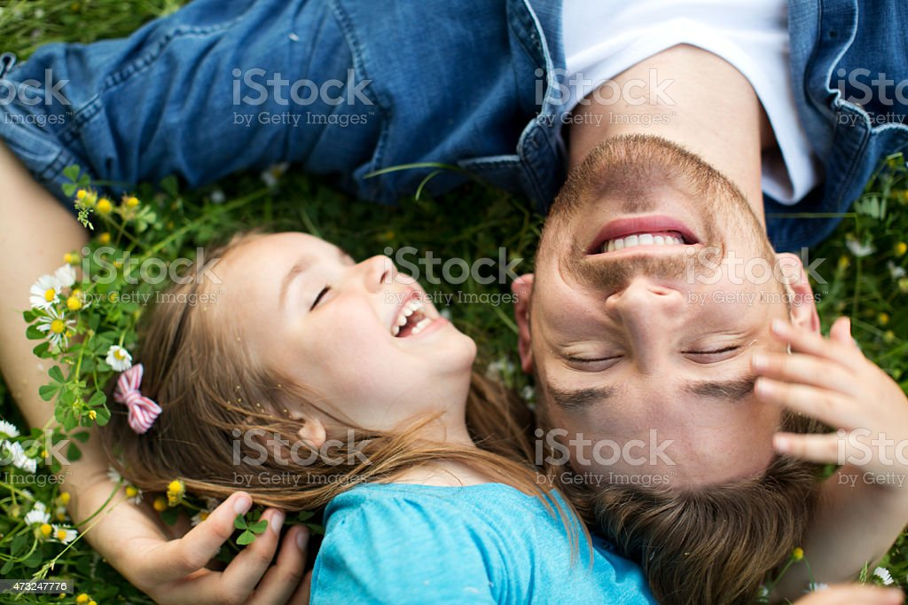 Father and daughter outdoors in a meadow. stock photo