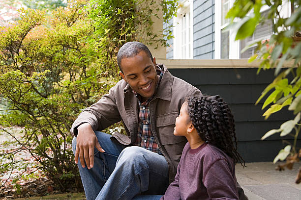Father and daughter outside house Father and daughter outside house single step stock pictures, royalty-free photos & images