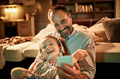 Close up of a father using a phone
