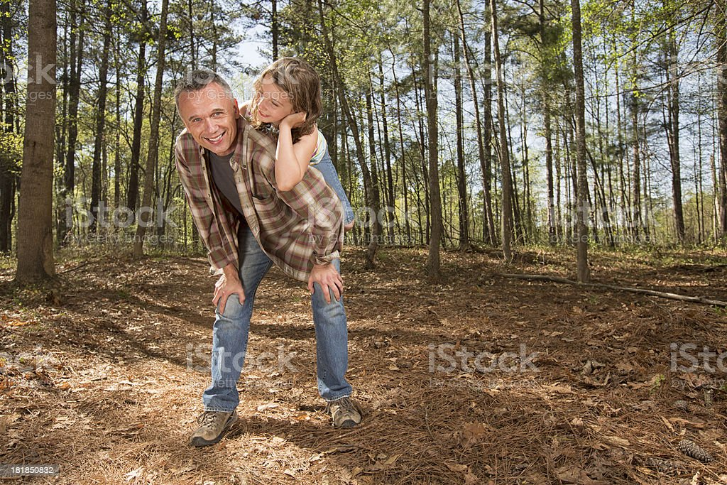 Father and Daughter piggyback in the woods royalty-free stock photo