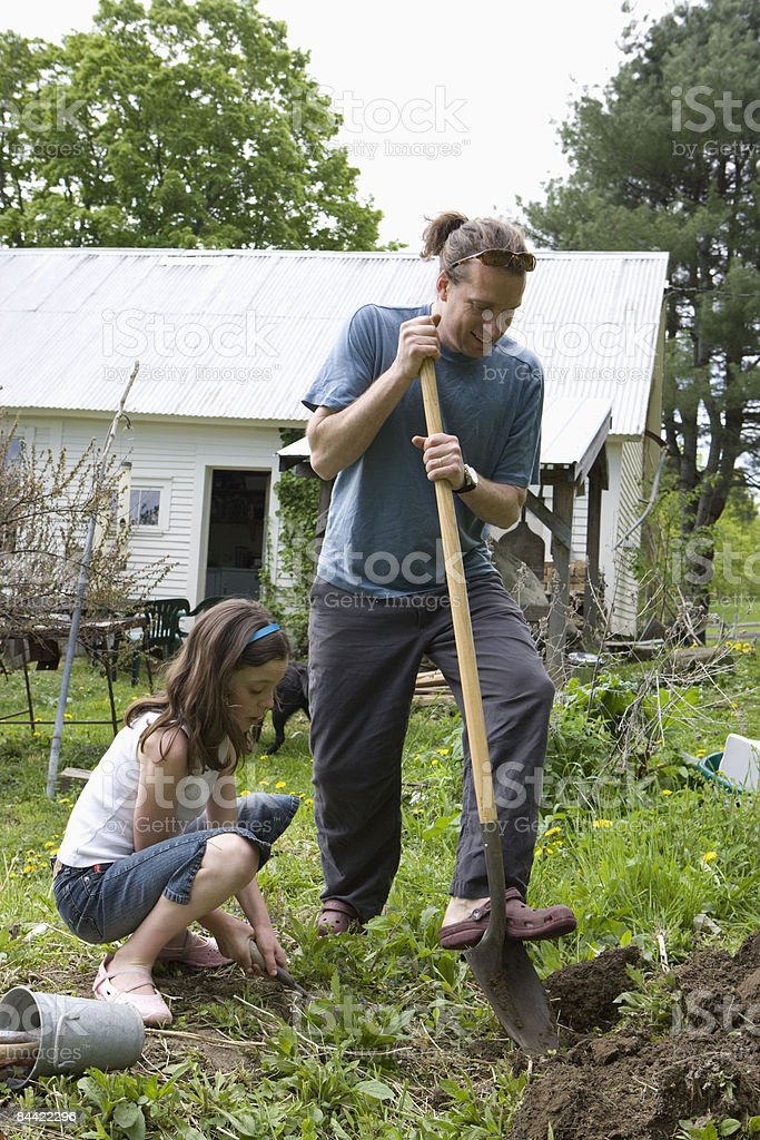 Father and daughter planting garden royalty-free stock photo