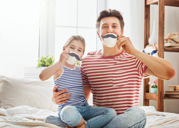 father and daughter play stock photo