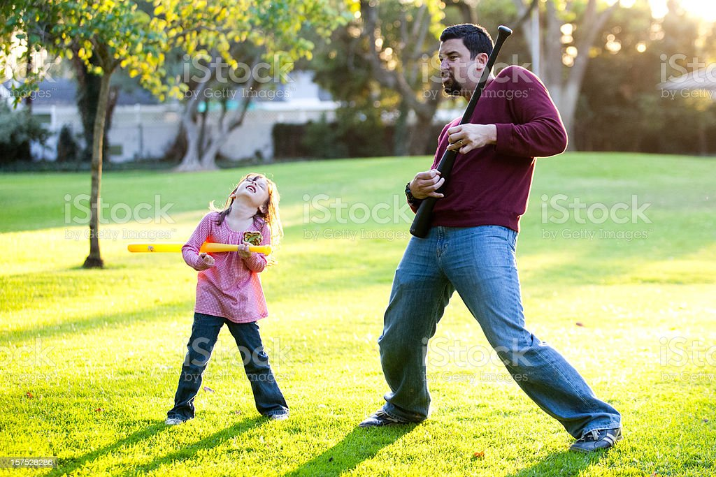 Father and Daughter playing Air Guitar stock photo