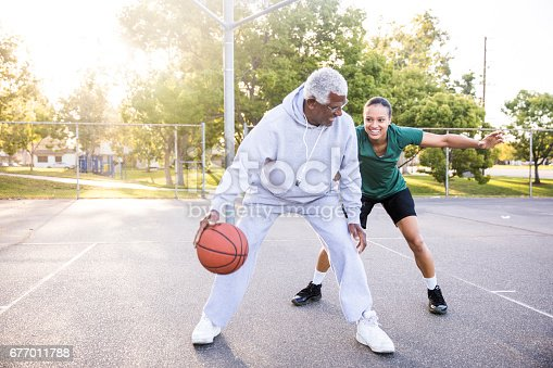 istock Father and Daughter Playing Basketball 677011788