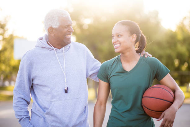 Father and Daughter Playing Basketball stock photo