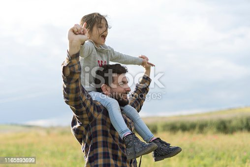 Father and daughter playing outdoors