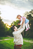 father and daughter having a fun in park