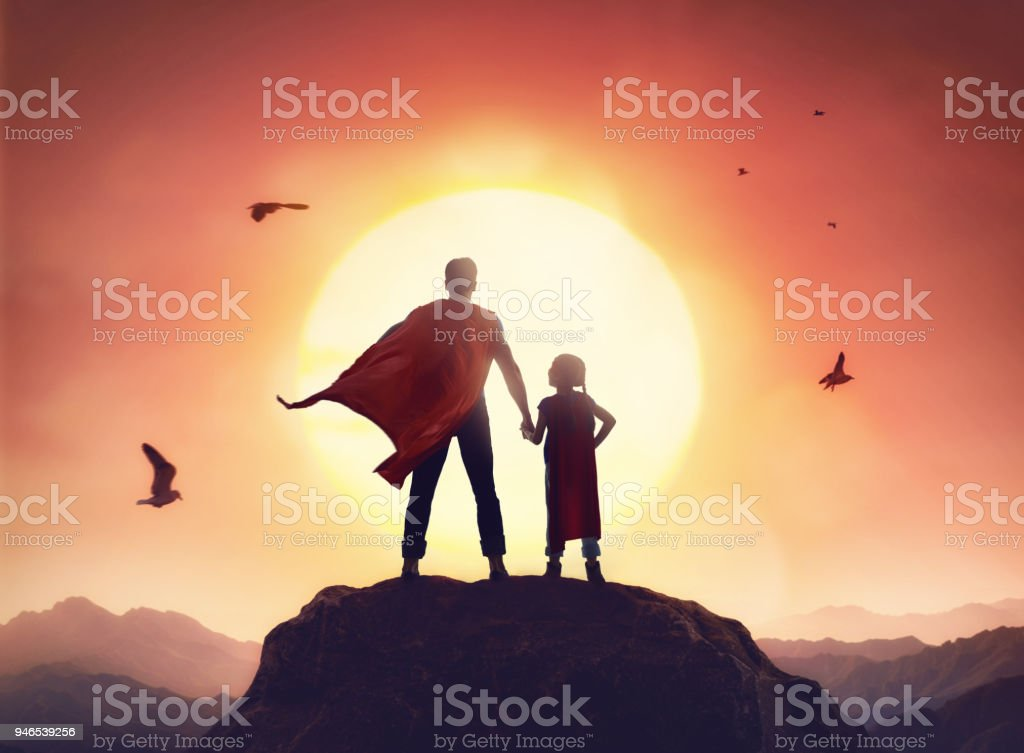Father and daughter playing outdoors stock photo