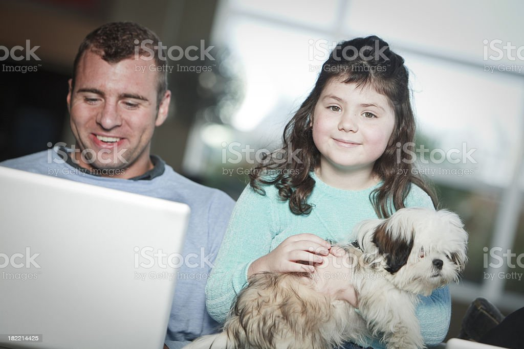 Father and daughter. Plus dog royalty-free stock photo