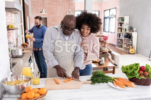 istock Father and daughter preparing dinner at home 1041493090