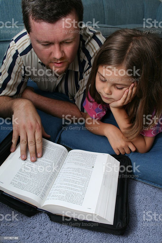Father and Daughter Reading The Bible royalty-free stock photo