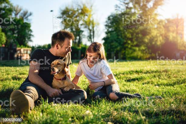 Father and daughter relaxing at park with dog picture id1004225050?b=1&k=6&m=1004225050&s=612x612&h=sjq0ym e9qasmud botpoucvk7o2cfzvj1t4q3n90ym=