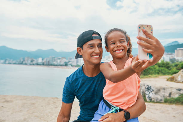 Father and daughter selfie time stock photo