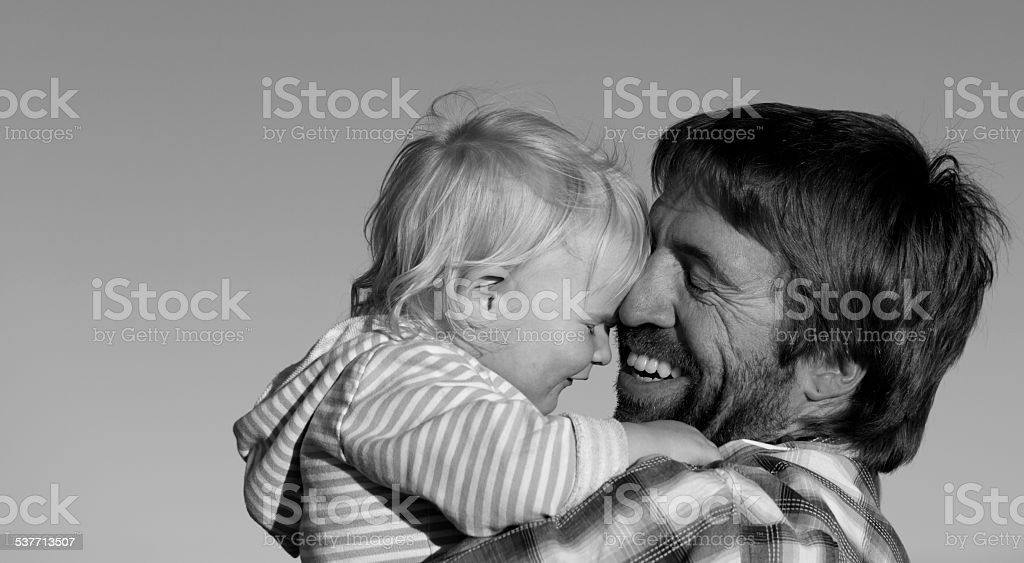 Father and daughter share a happy moment. stock photo