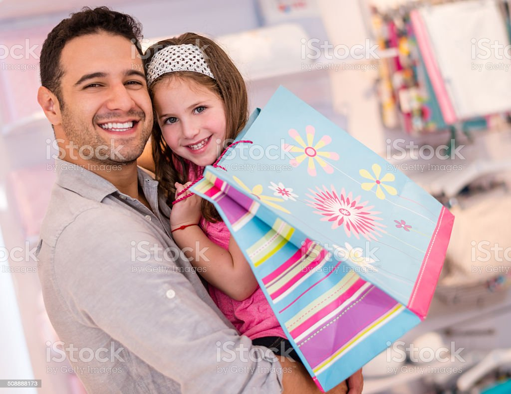 Father and daughter shopping stock photo