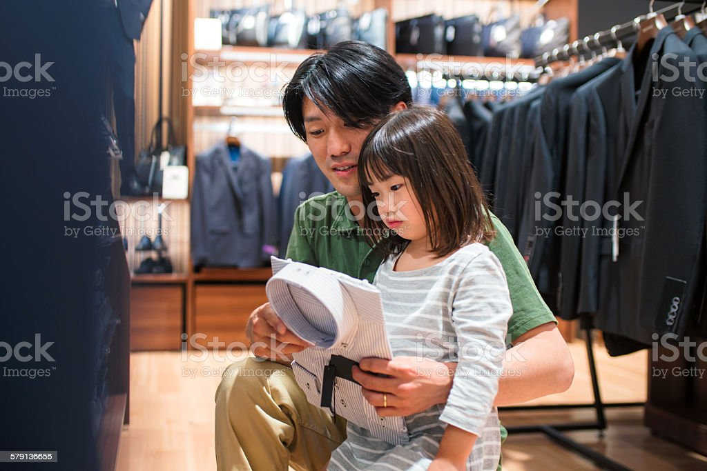 Father and daughter shopping together stock photo