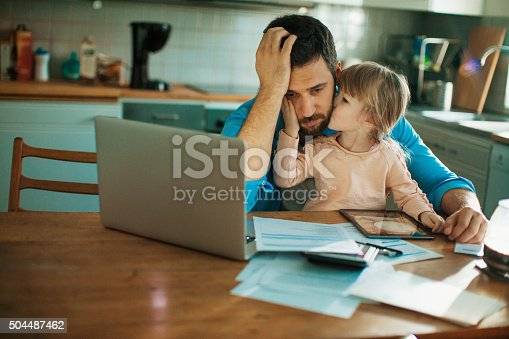 istock Father and daughter sitting in the kitchen 504487462