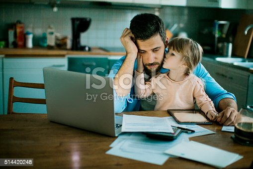 istock Father and daughter sitting in the kitchen 514420248