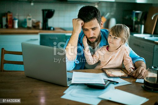 istock Father and daughter sitting in the kitchen 514420306