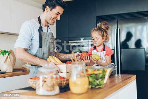 istock Father and daughter sorting fresh fruits 636653138