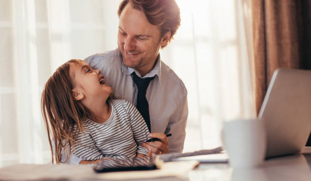 Father and daughter spending time together stock photo