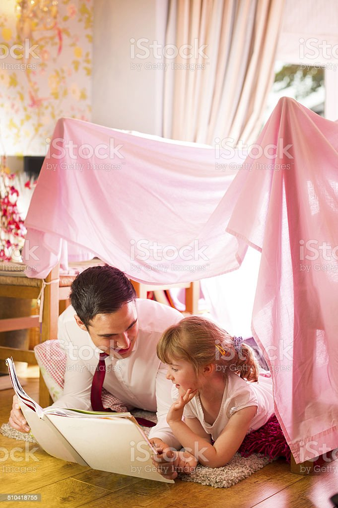father and daughter storytime stock photo