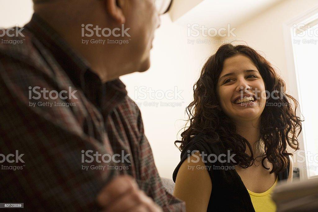 father and daughter talking royaltyfri bildbanksbilder