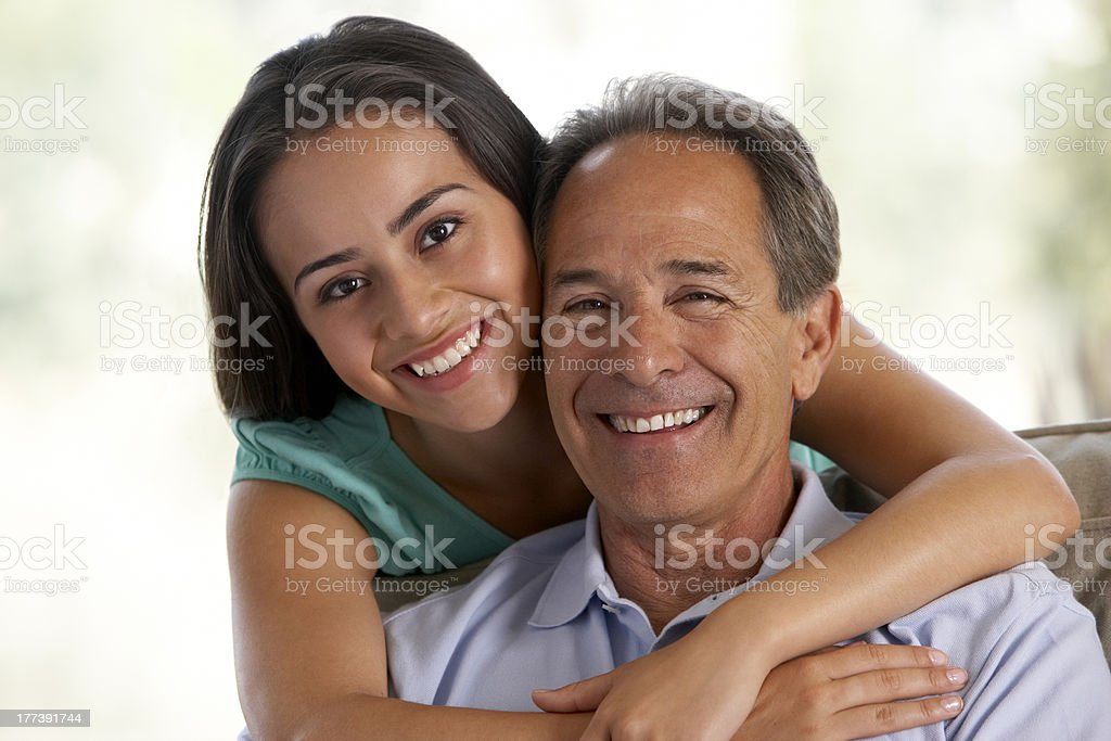 Father And Daughter Together At Home stock photo