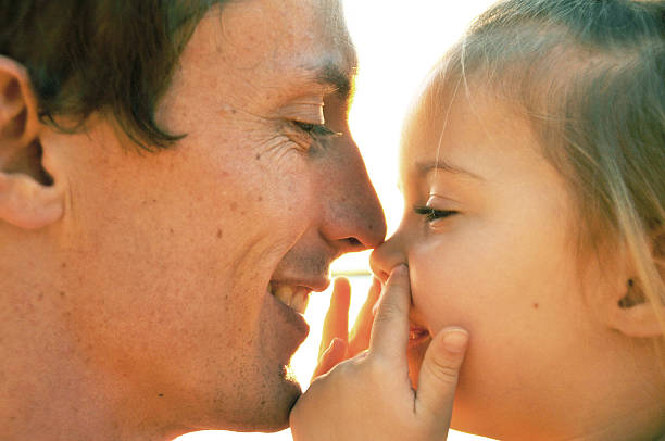 Father and Daughter touch noses stock photo