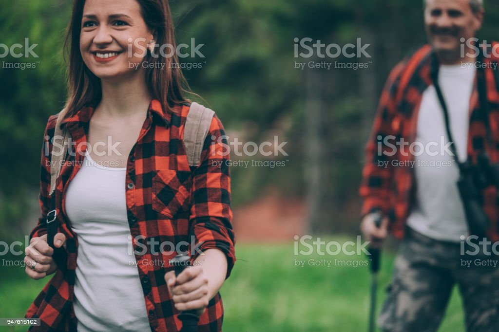 Father and daughter trail hiking on high mountain stock photo